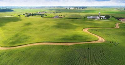 Despite poor grain prices, land values could go either way. Here's 9 trends to watch.